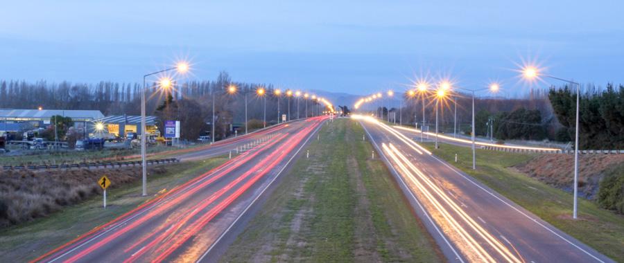 Time-lapse shot of traffic on the current Waimakariri River bridge at dusk.